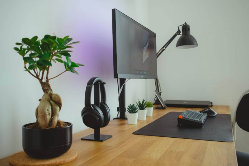black flat screen tv on brown wooden table